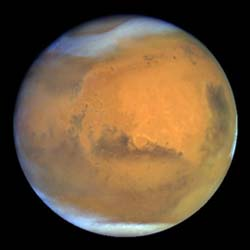 Because of the low atmospheric pressure, and with little to no methane or water vapor to reinforce the weak greenhouse effect, Mars has a largely frozen surface that shows no evidence of life.